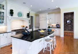 country kitchen white cabinets black countertop