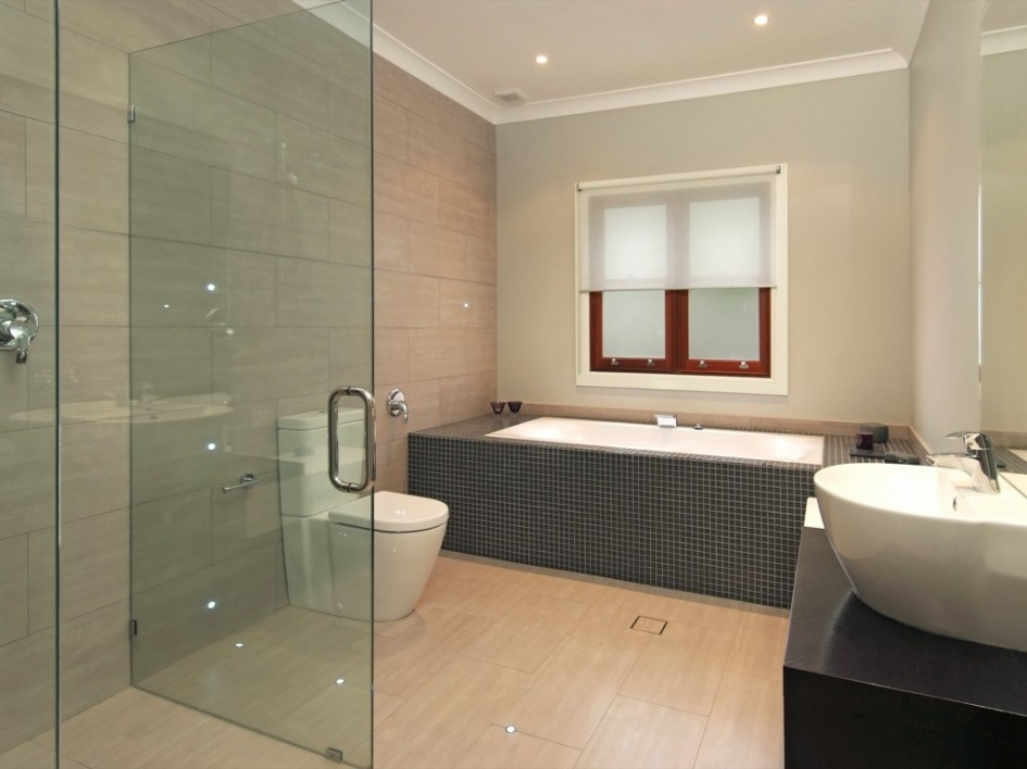 Modern Creamy Bathroom Design With Cool Black Vanity Cabinets With Storage and White Vessels Sinks