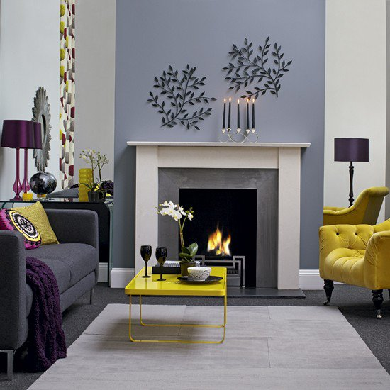 modern grey and yellow living room with fireplace inside