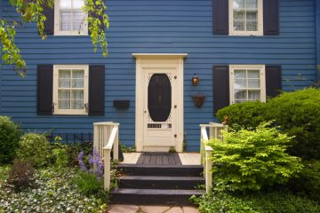 county house with cool blue wooden front doors