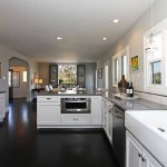 dark black hardwood floors for modern kitchen with white cabinets