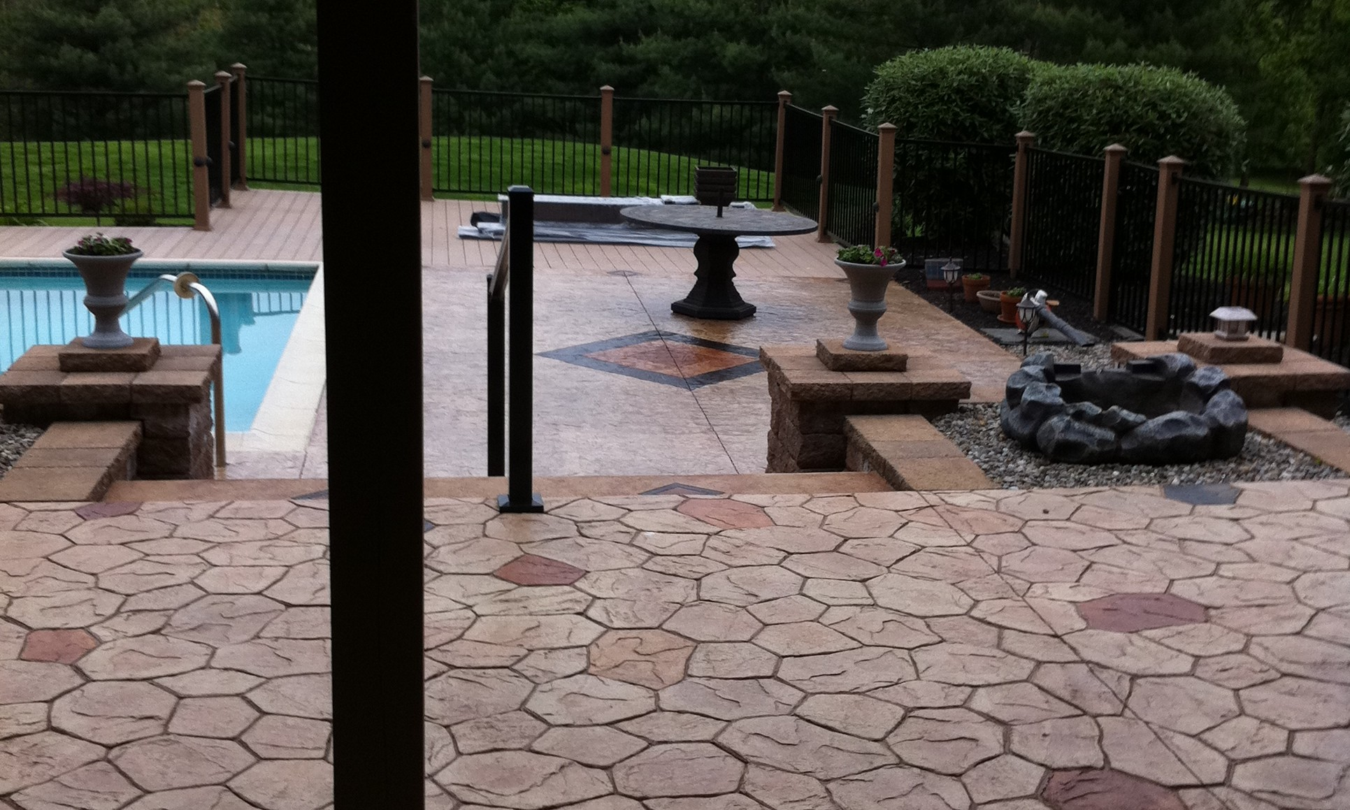 Cozy Look Stamped Concrete Patio Design For Pool Decks and Patio Space