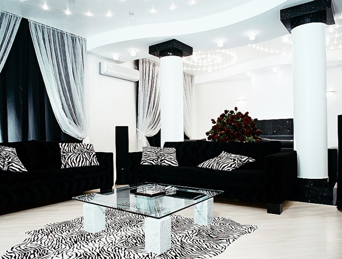 VIEW IN GALLERY Awesome Black Leather Modern Sofa In White Theme Living Room  With Cool Vanity Lighting
