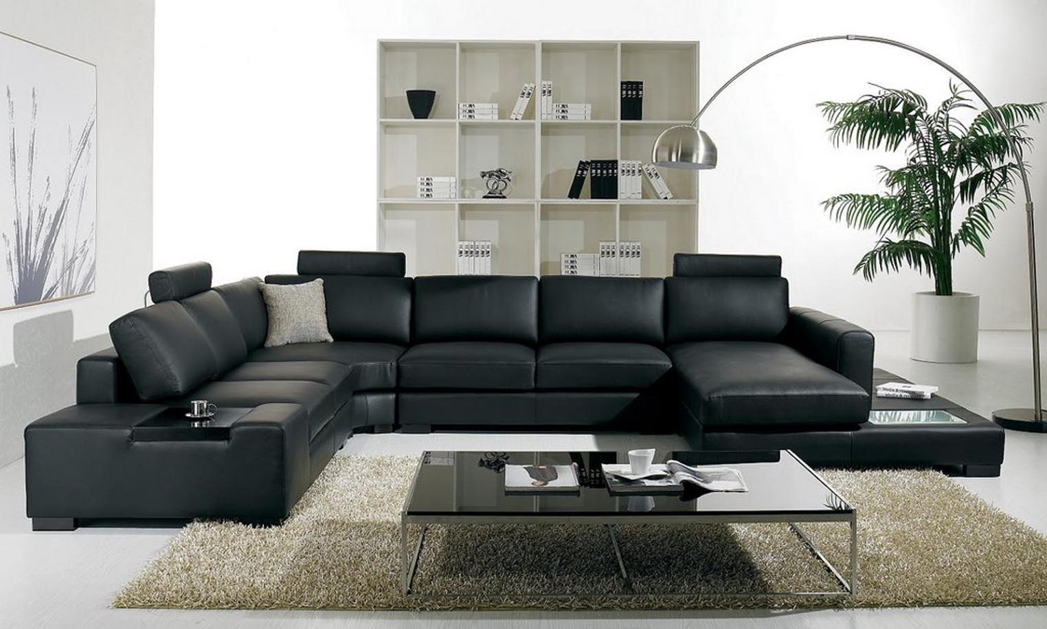 VIEW IN GALLERY Luxury Black Leather Sectional Sofa For Living Room Interior Decoration With Cool Glass Top Coffee Table