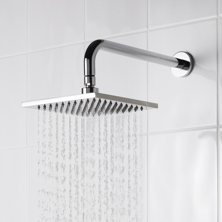 Rain Shower Head With Modern Arm Wall Mount Attached On White Ceramic Tile