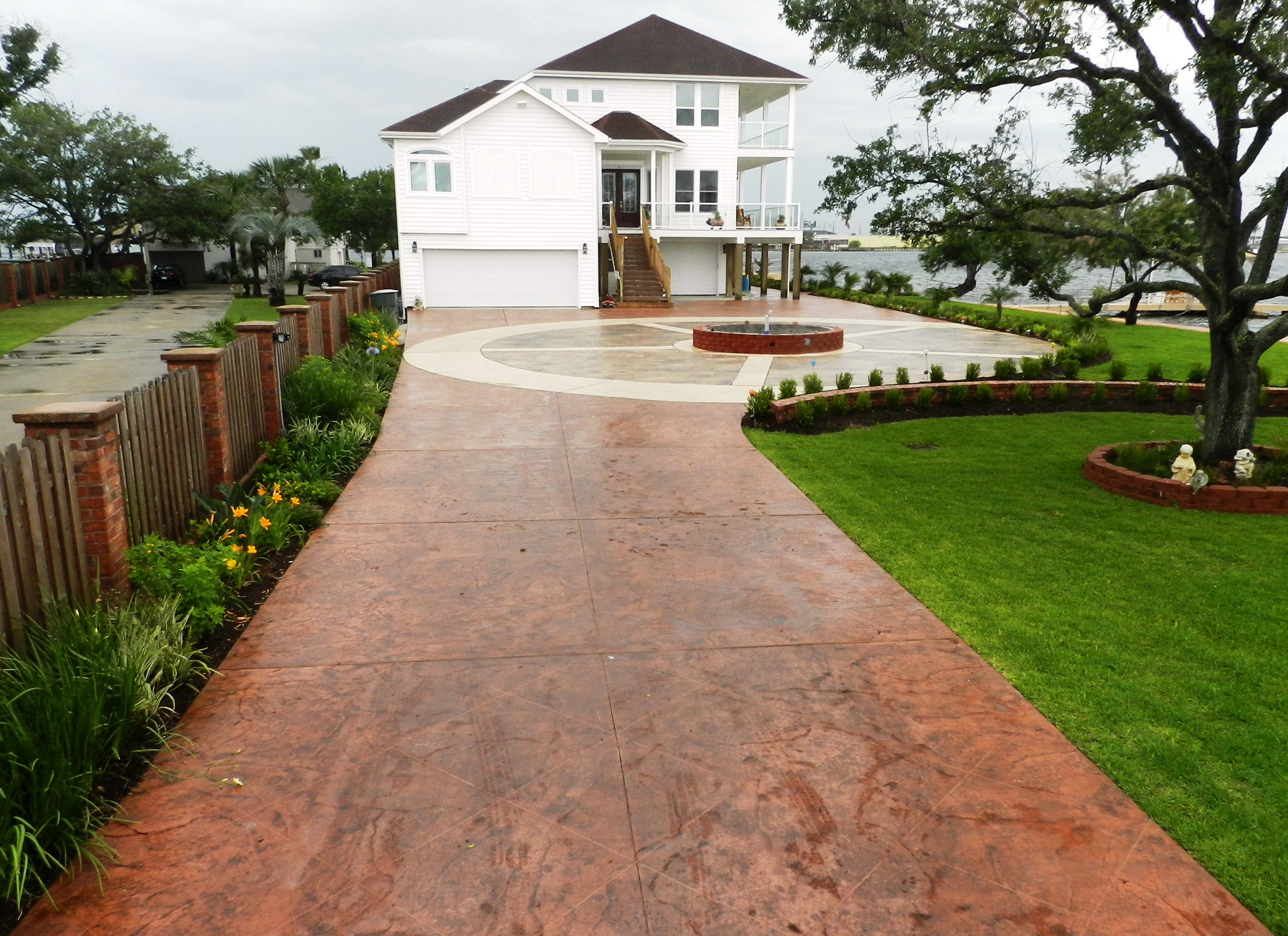 stamped concrete designs ideas for stamped concrete driveway with cool front yard patio designs