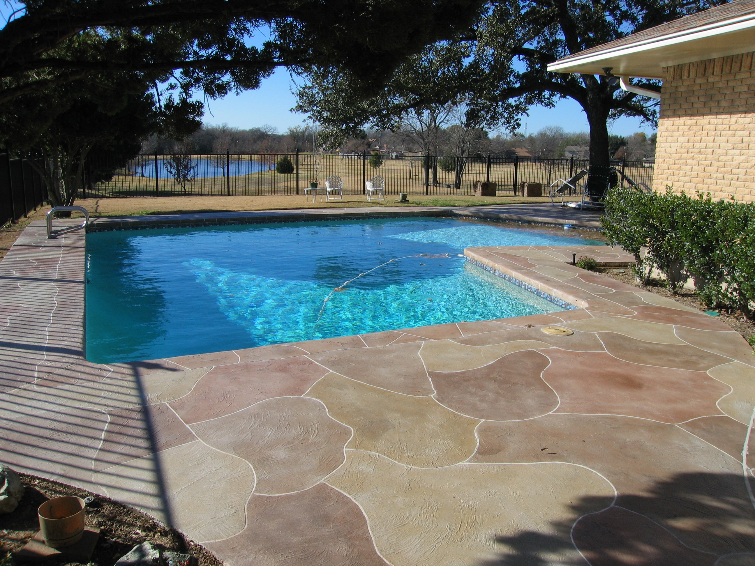 Stamped concrete driveway patio design ideas everything for Ideas for a pool