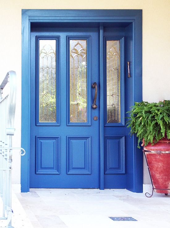 traditional front doors painted with blue