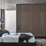 Modern contemporary interior design with grey custom fitted wardrobes with sliding door