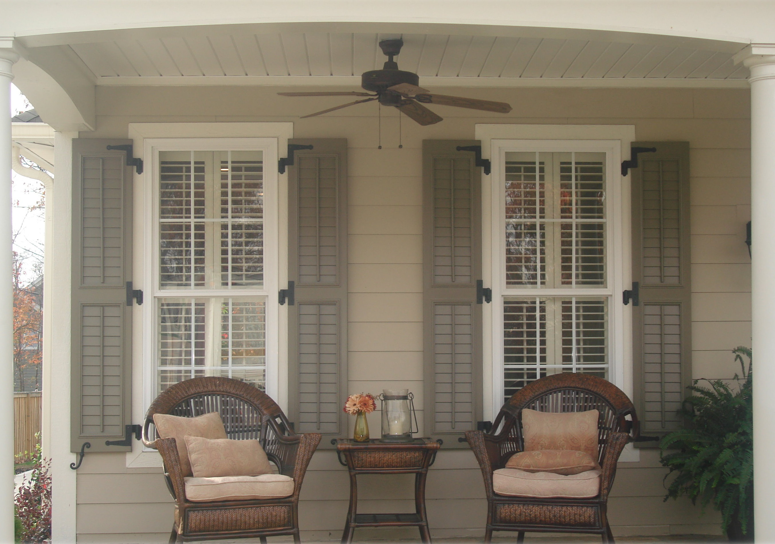 VIEW IN GALLERY Rustic Exterior Window Shutters Installation Ideas