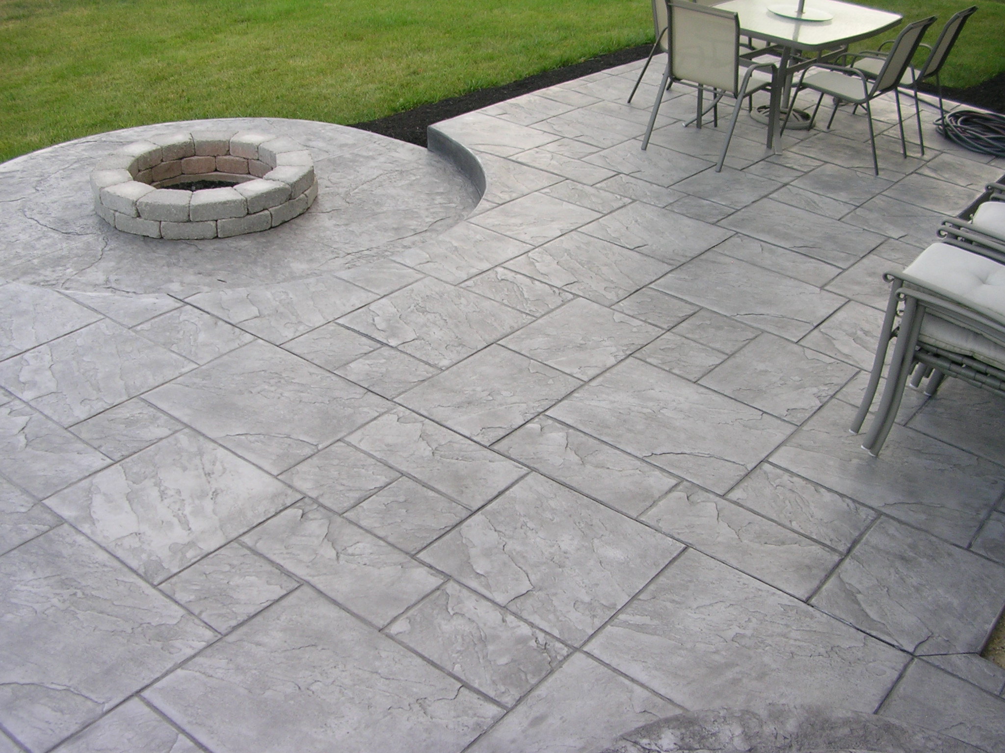 Concrete Patio Design Ideas i like the idea of rounded stairs coming from our patio door View In Gallery Stamped Concrete Patio Ideas To Bring Your Patio Backyard Or Frontyard More Welcoming Space
