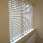 Replace Your Windows Treatments With Wooden Venetian Blinds.