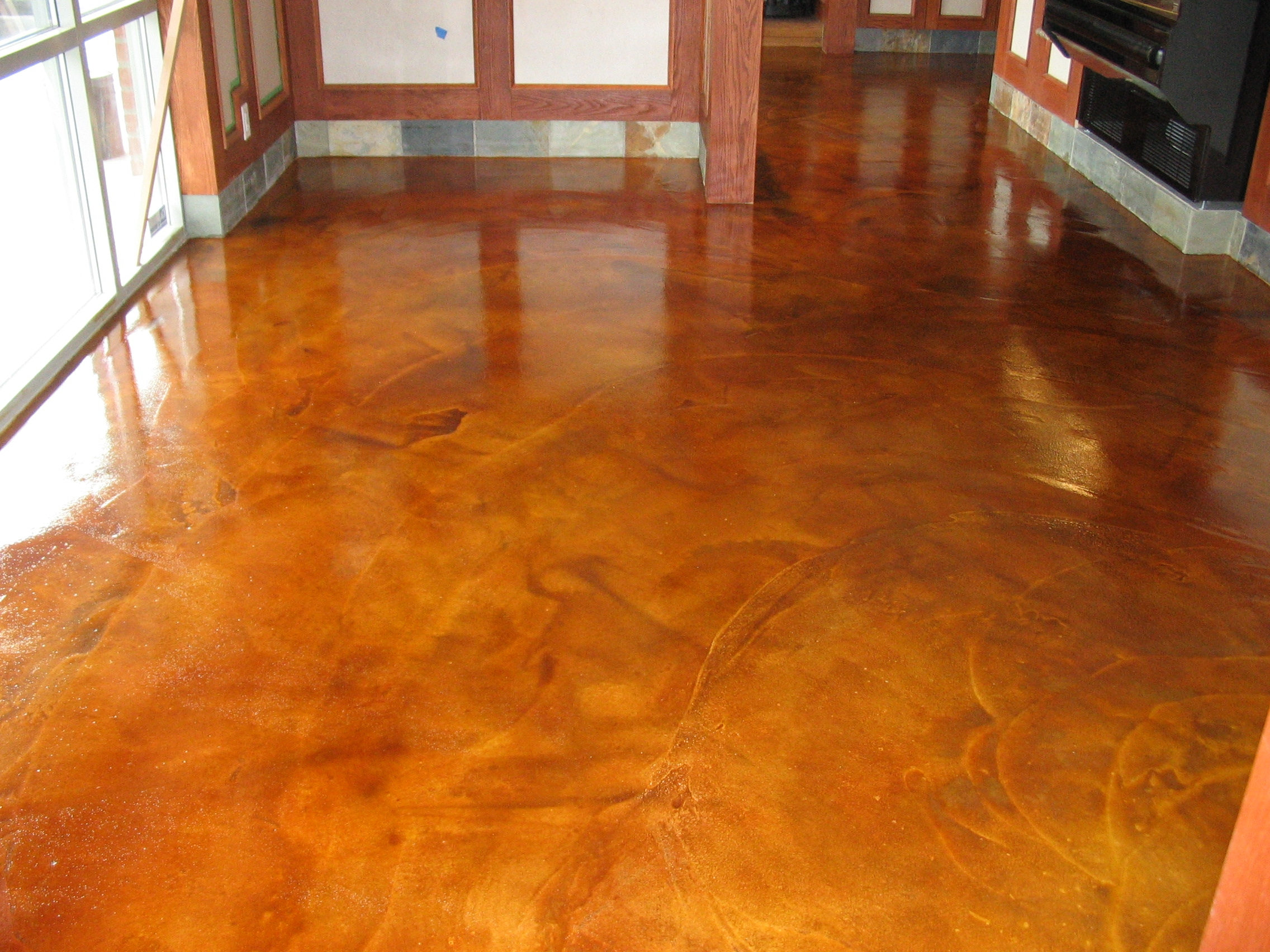 Stained concrete floors for different home flooring ideas for Stained polished concrete floor
