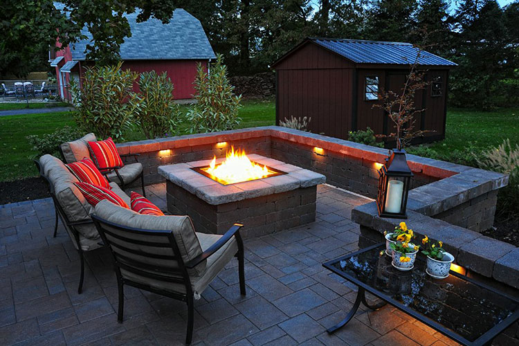High durability concrete stamped patio design ideas with resin wicker patio furniture and fireplace for cool patio backyard and landscaping ideas