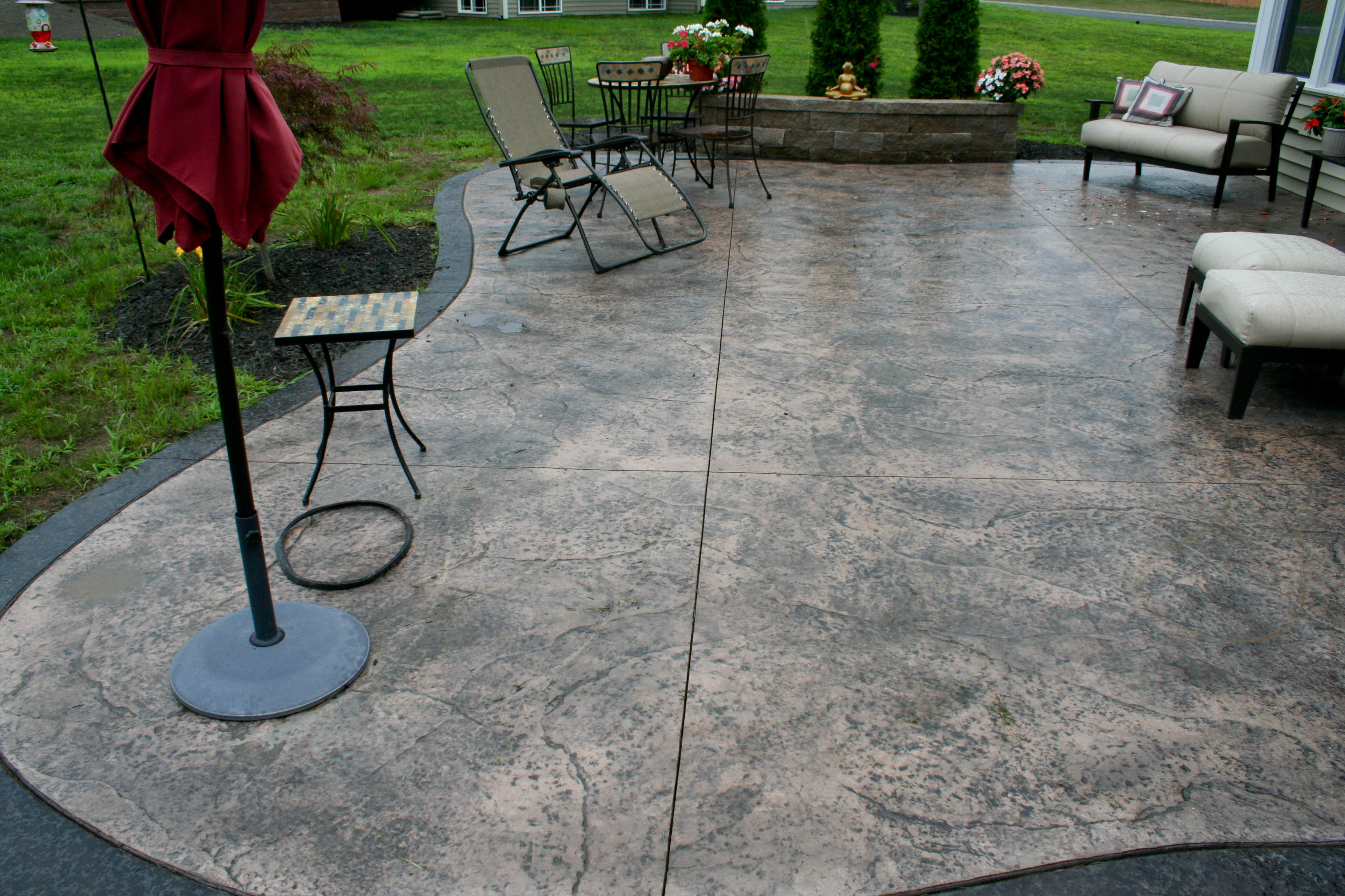 Patio floor design ideas stamped concrete designs for Stamped concrete patterns flooring options design with stairs with backyard patio wrought iron furniture