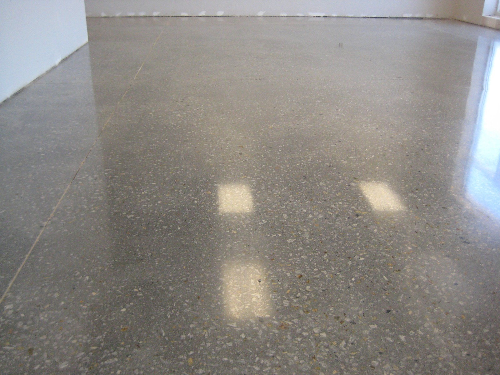 Stained concrete floors for different home flooring ideas for How to shine cement floor